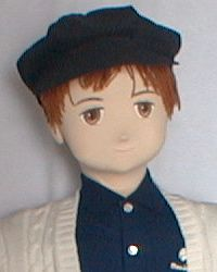Boy doll in cap