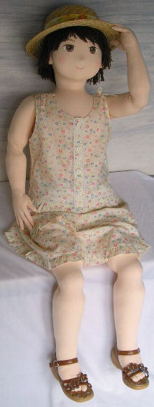 Life size doll in sundress